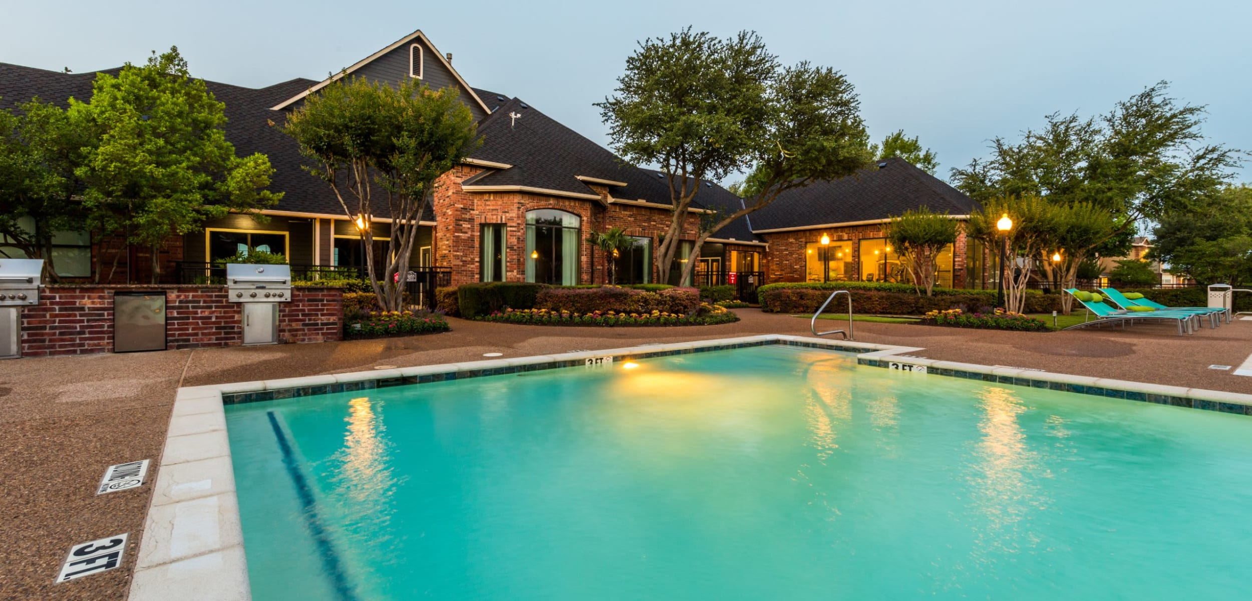 Lit pool near clubhouse at Marquis at Stonebriar in Frisco, Texas