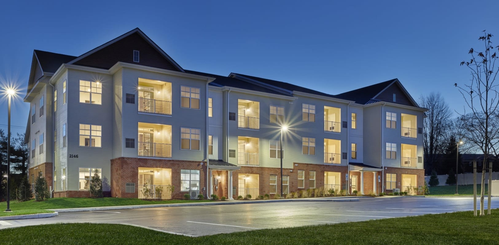 Professionally maintained landscaping and clean sidewalks outside resident buildings at The Mills at Lehigh in Bethlehem, Pennsylvania