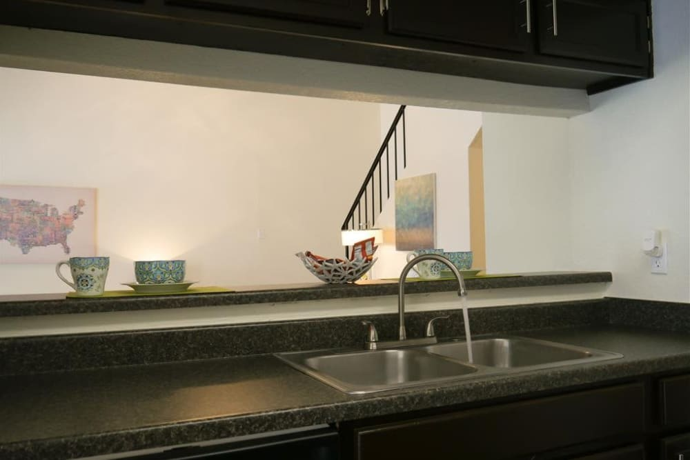 Kitchen view into living room at The Park at Ashford in Arlington, Texas