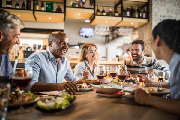 Residents enjoying a neighborhood restaurant near Aventura at Mid Rivers in Saint Charles, Missouri.
