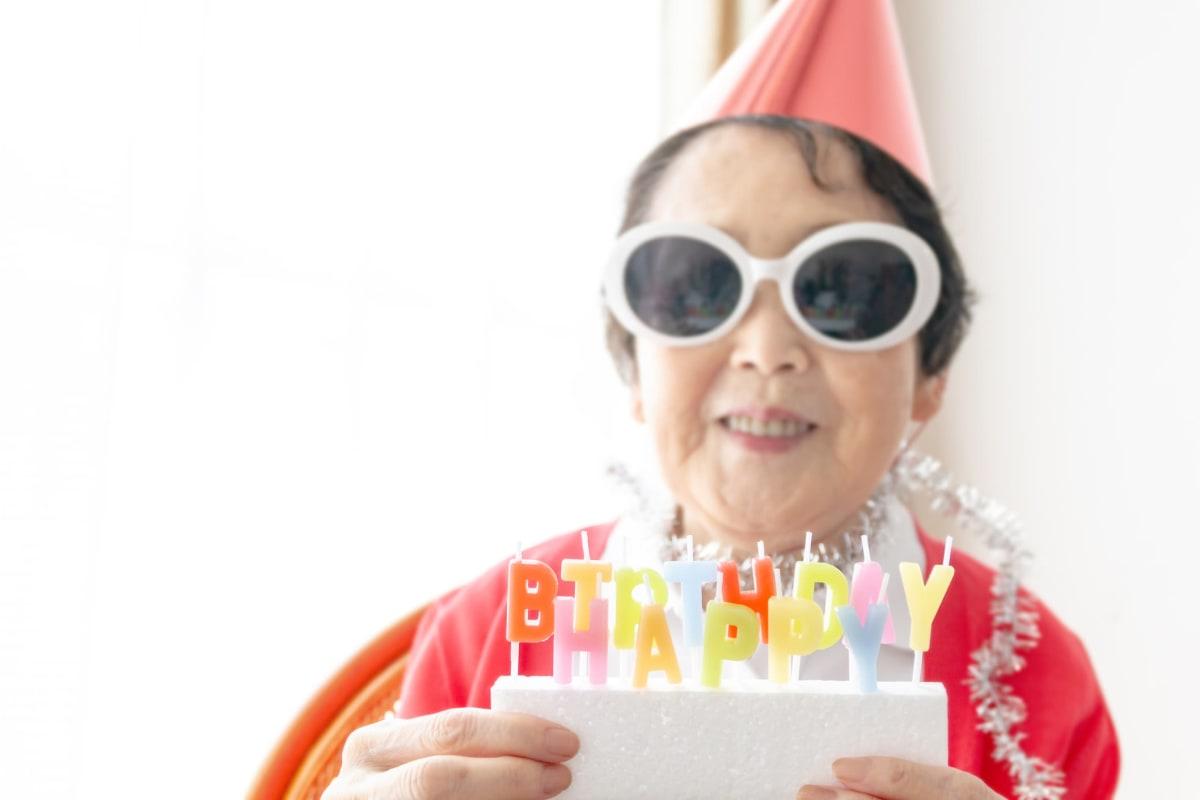 Resident celebrating a birthday at Oxford Glen Memory Care at Grand Prairie in Grand Prairie, Texas