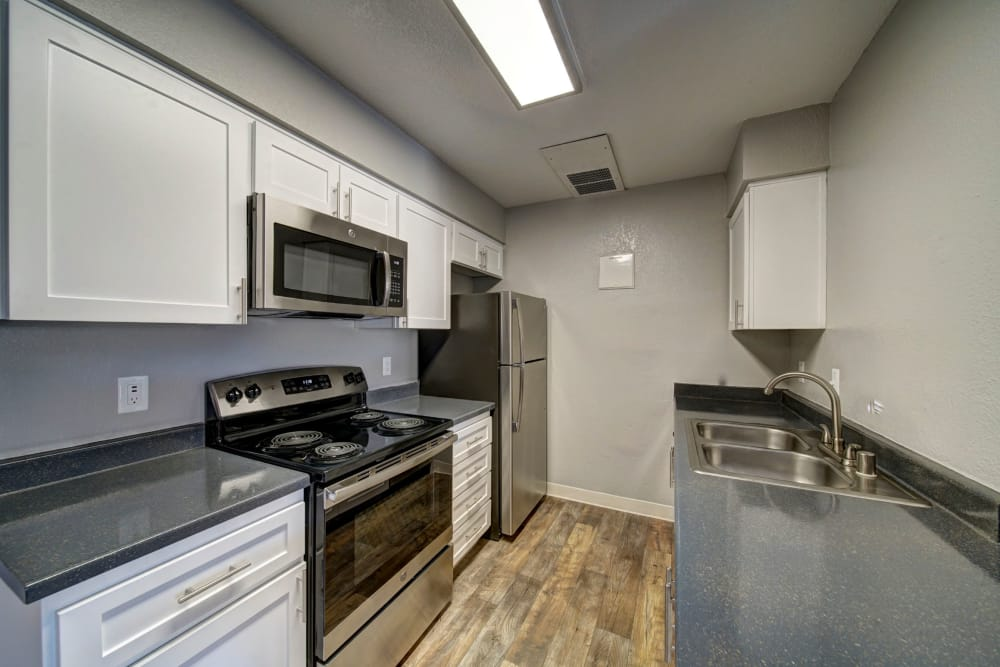 white Kitchen with ample counter space at Parkside Commons Apartments