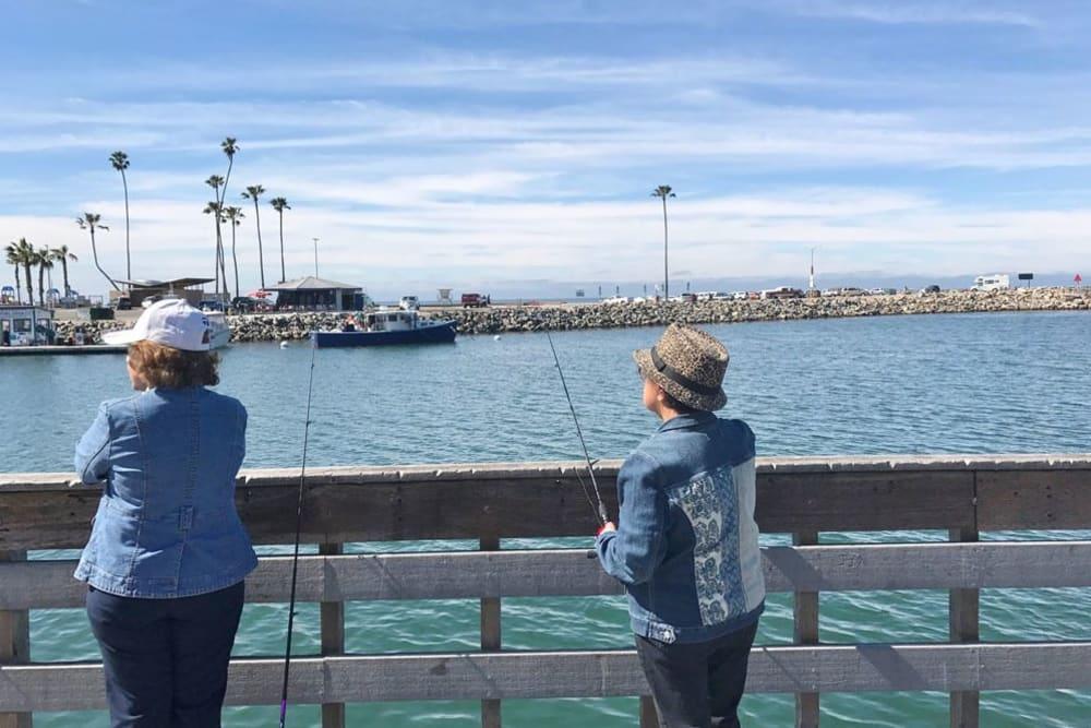 Residents fishing near Merrill Gardens at Oceanside in Oceanside, California