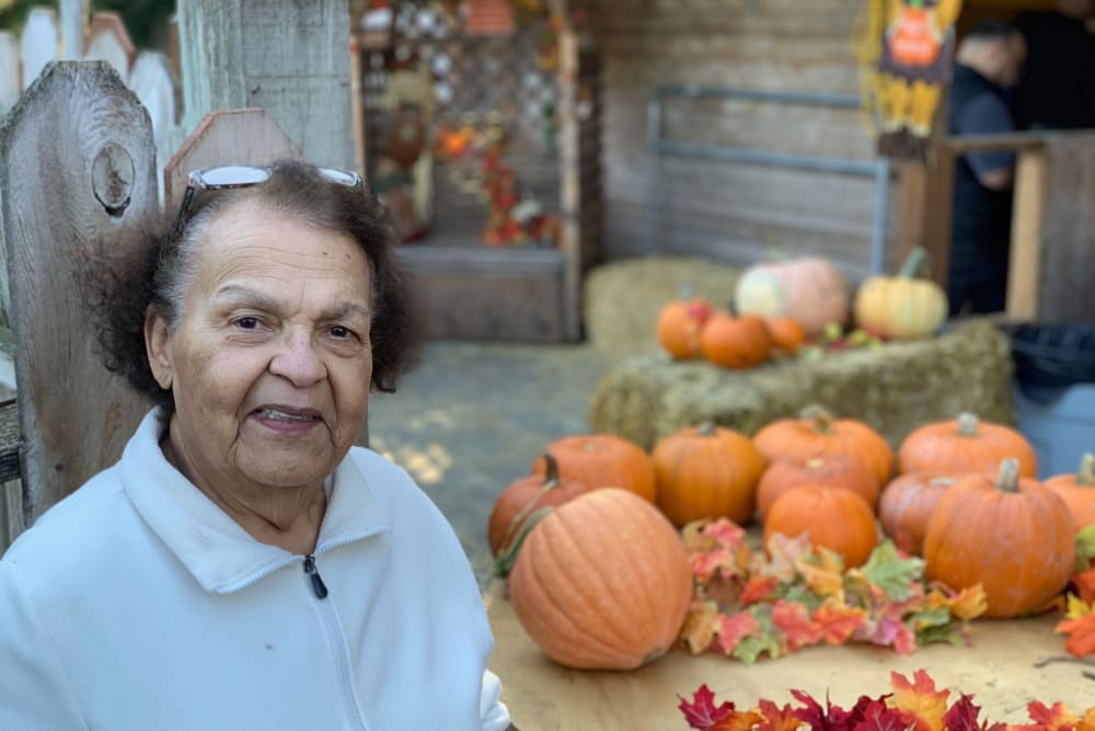 Resident smiling at the Pumpkin Patch near Merrill Gardens at First Hill in Seattle, Washington.