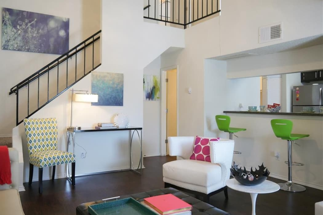 Well-decorated living room and breakfast bar view at The Park at Ashford in Arlington, Texas