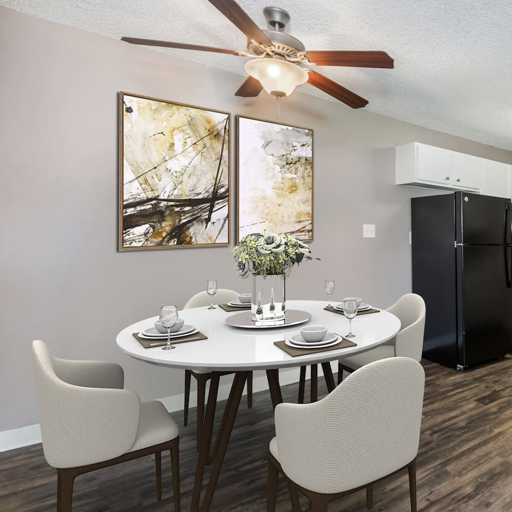 Dining table by kitchen at Florida Station Apartments in Aurora, Colorado