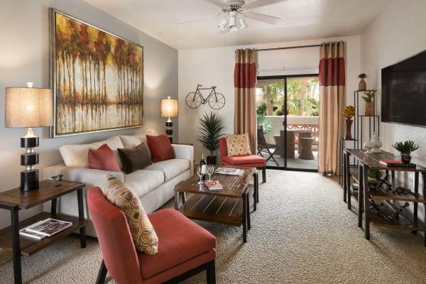 Model living room with unique accent lighting at San Prado in Glendale, Arizona