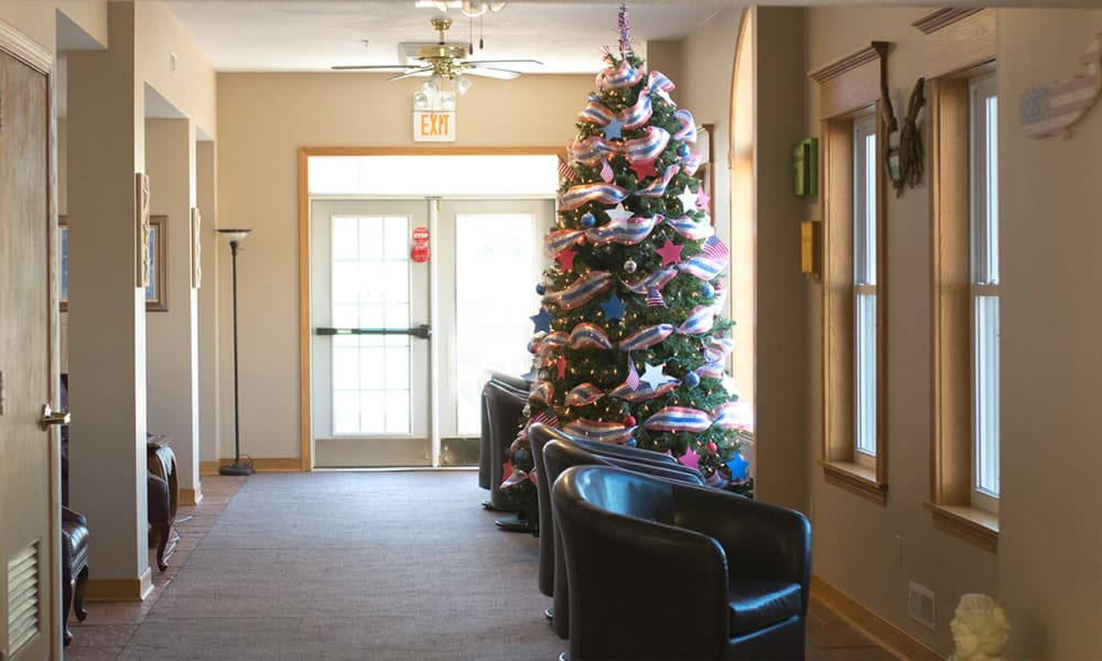 Seating next to a Christmas tree at Clearview Lantern Suites in Warren, Ohio