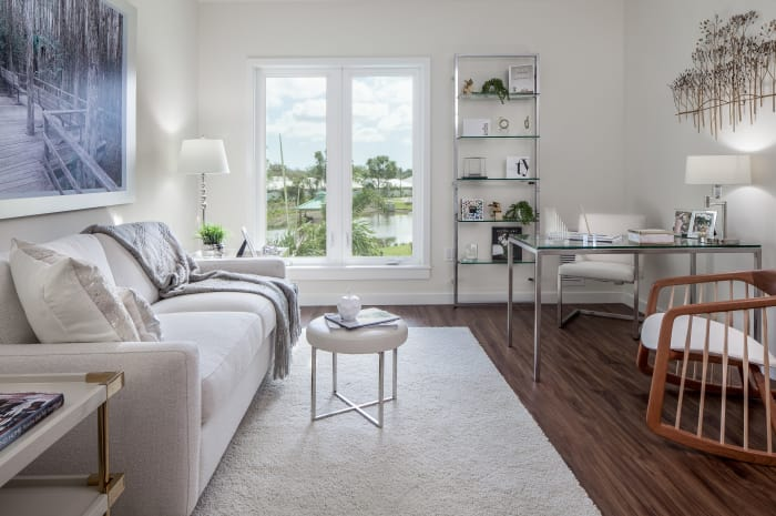 Living room with patio access at All Seasons Naples in Naples, Florida
