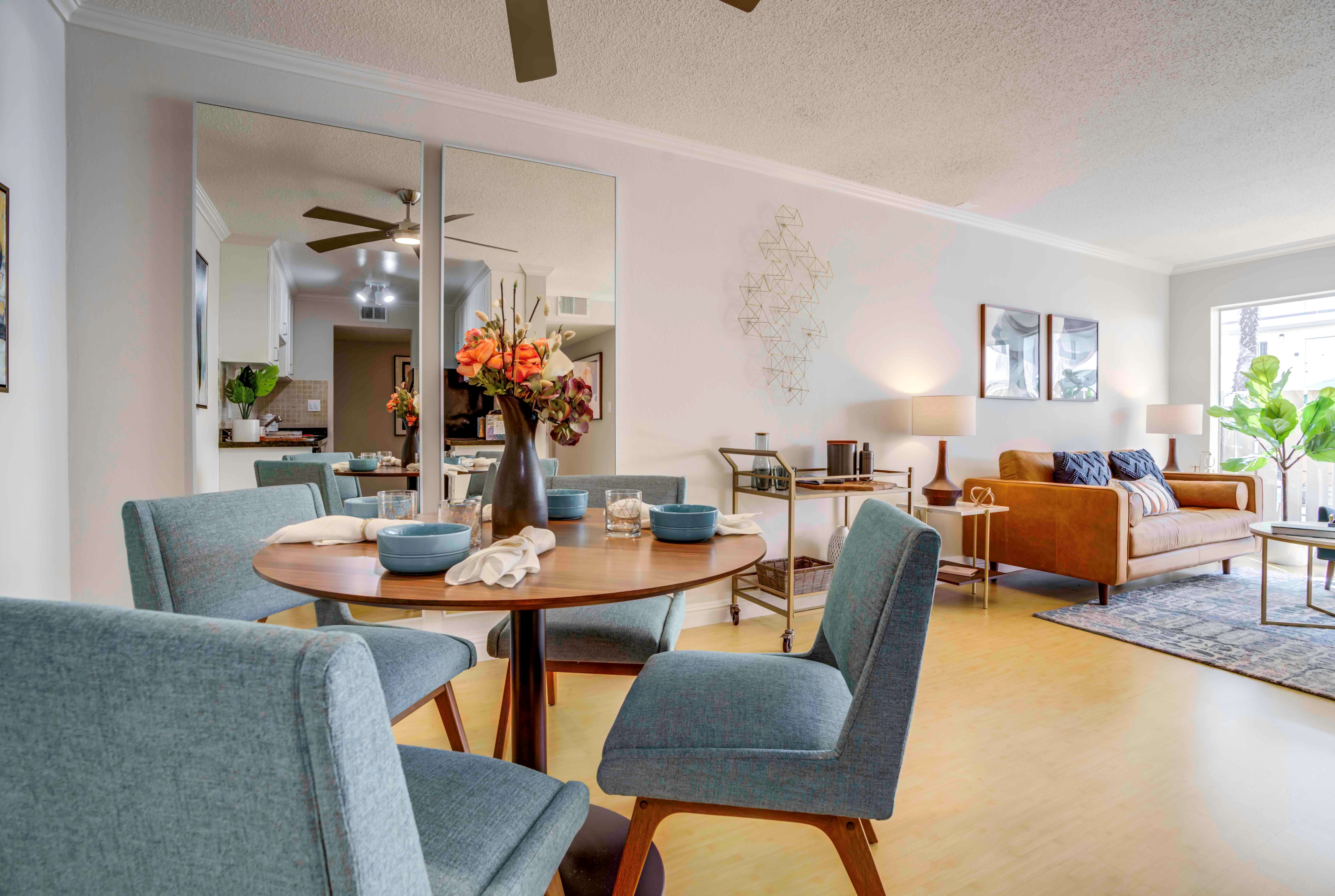 Well-furnished living area in the open-concept floor plan of a model home at Sofi Redwood Park in Redwood City, California