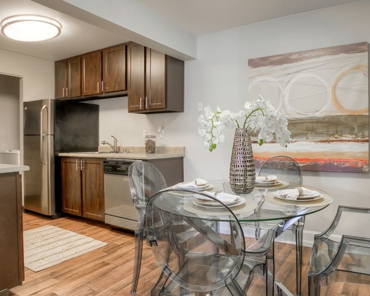 Kitchen and dining room at Newport Crossing Apartments in Newcastle,