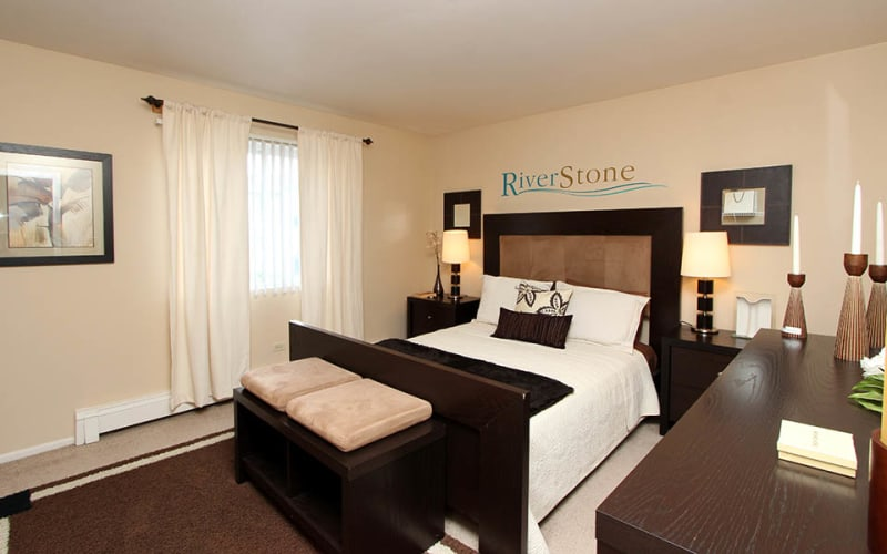 Spacious master bedroom with plush carpeting at Riverstone Apartments in Bolingbrook, Illinois