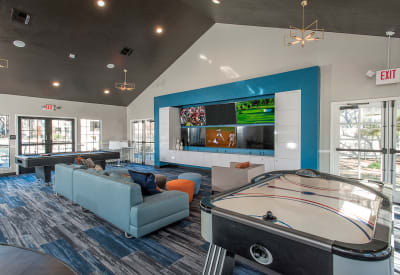 Well-decorated resident clubhouse with air hockey and billiards at Slate Creek Apartments in Roseville, California