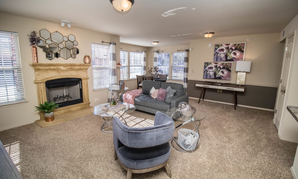 Well decorated living room with a fireplace at Tuscany Place in Lubbock, Texas