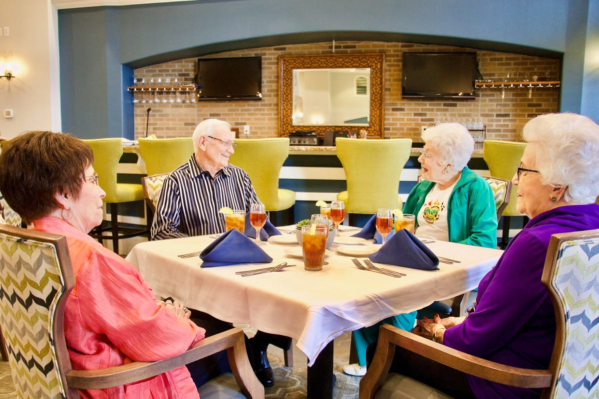 A group having a meal at Landing at Watercrest Shadow Creek Ranch in Pearland, Texas