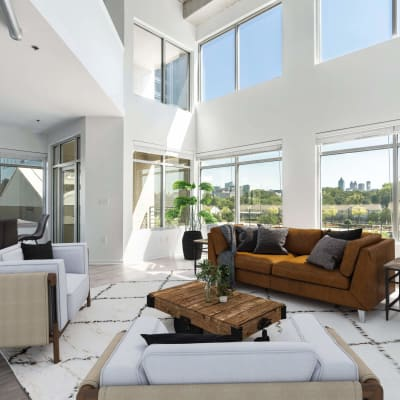 Gorgeous living room with tall ceilings at 17th Street Lofts in Atlanta, Georgia