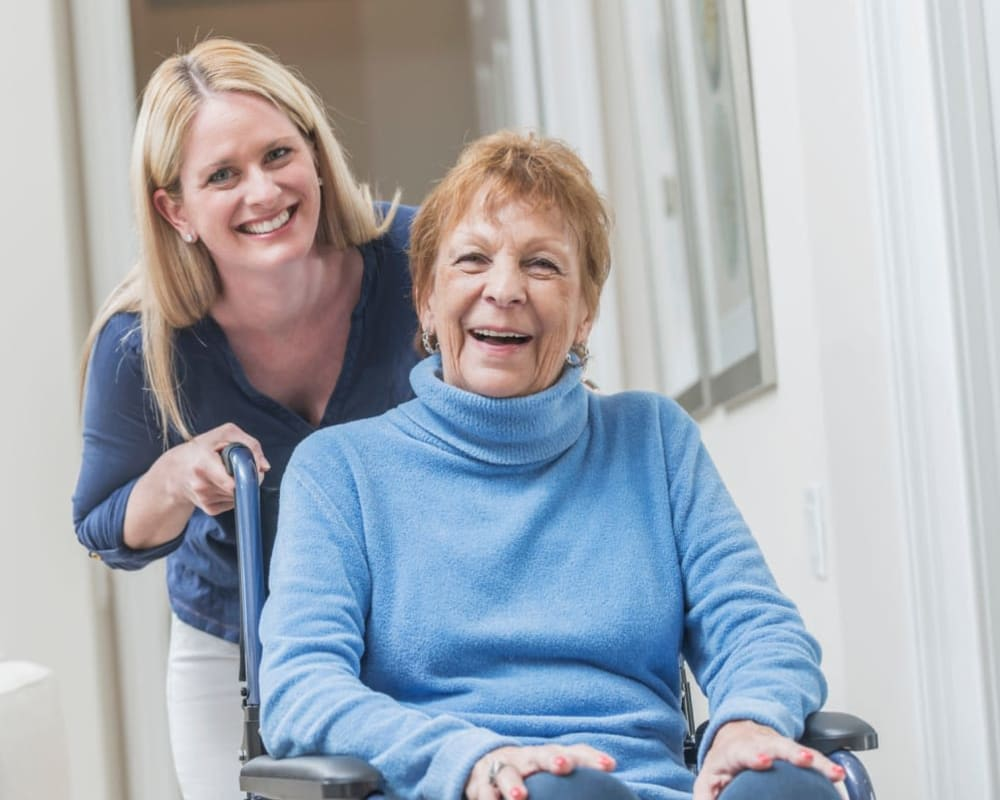 Staff helps resident in apartment at Willows Landing in Monticello, Minnesota.