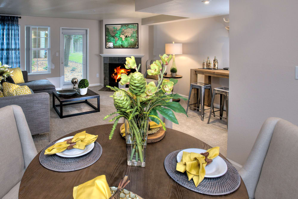 Dining room with a living room view at Slate Ridge at Fisher's Landing Apartment Homes in Vancouver, Washington