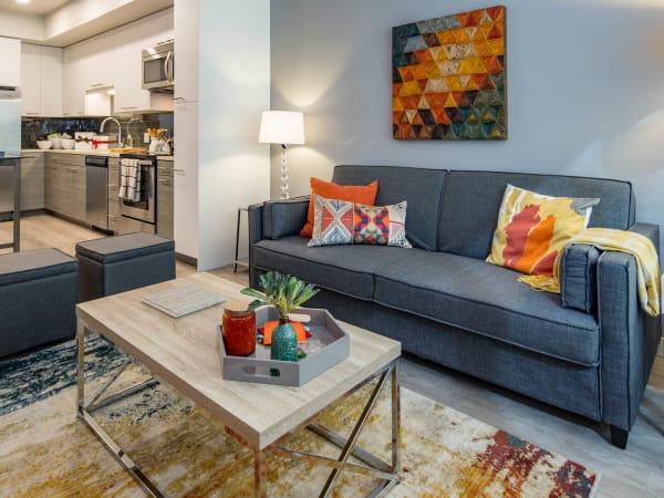 Modern decor in the open-concept living area of a model home at EVIVA Midtown in Sacramento, California