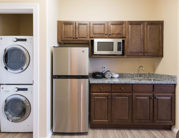 Spacious independent living floor plan with in-unit washer and dryer at Burr Ridge Senior Living