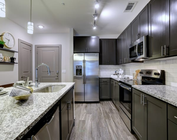 Bright, fully equipped kitchen at The Sawyer at One Bellevue Place in Nashville, Tennessee