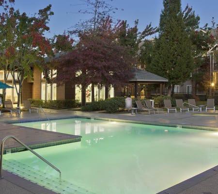 Beautiful swimming pool as dusk in Cortland Village Apartment Homes in Hillsboro, Oregon