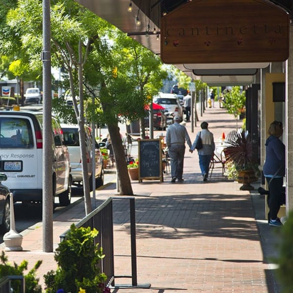 Residents looking at local shops near The Meyden in Bellevue, Washington