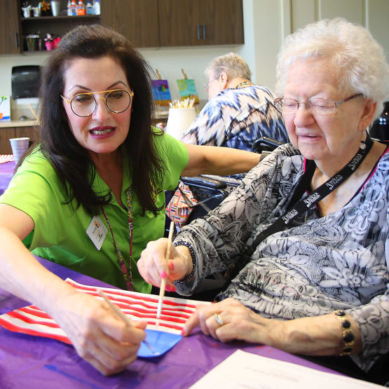 Resident painting with our Activities director at Prairie House Assisted Living and Memory Care in Broken Arrow, Oklahoma