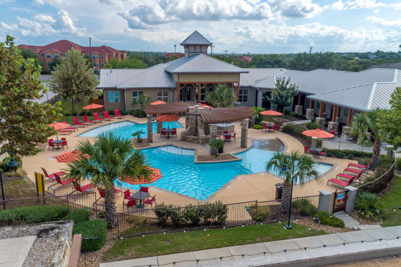 Aerial view of clubhouse and pool at Firewheel Apartments in San Antonio