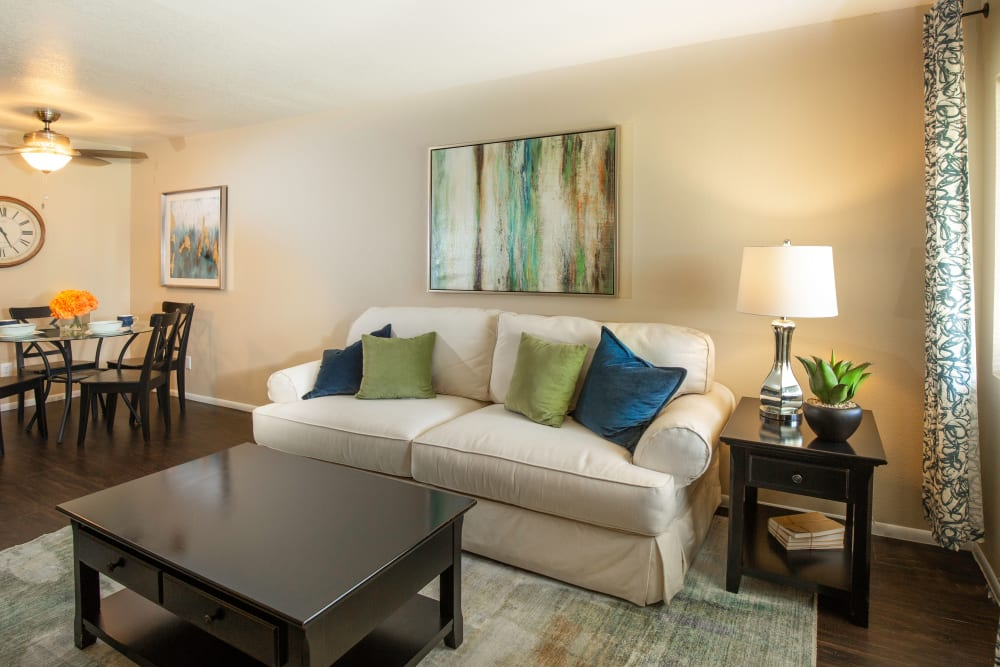 A cozy apartment living room with a love seat at Callaway Apartments in Taylorsville, Utah