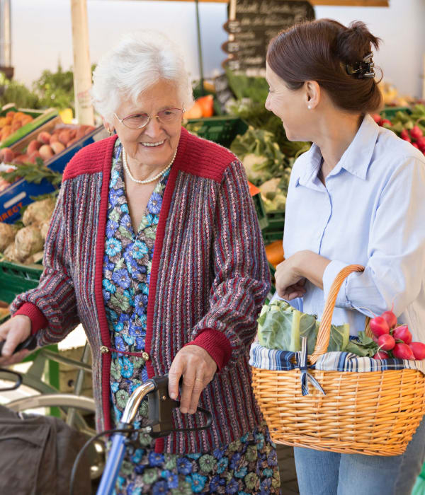 Shopping at the grocery store resident and caretaker near The Phoenix at Savannah in Savannah, Georgia
