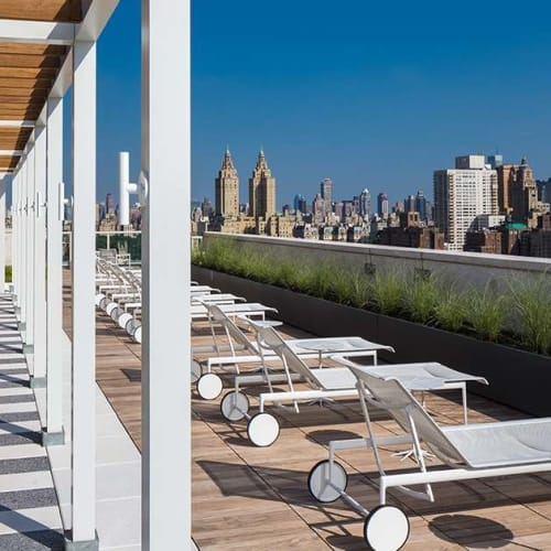 Roof-top deck with lounge chairs at The Larstrand in New York, New York