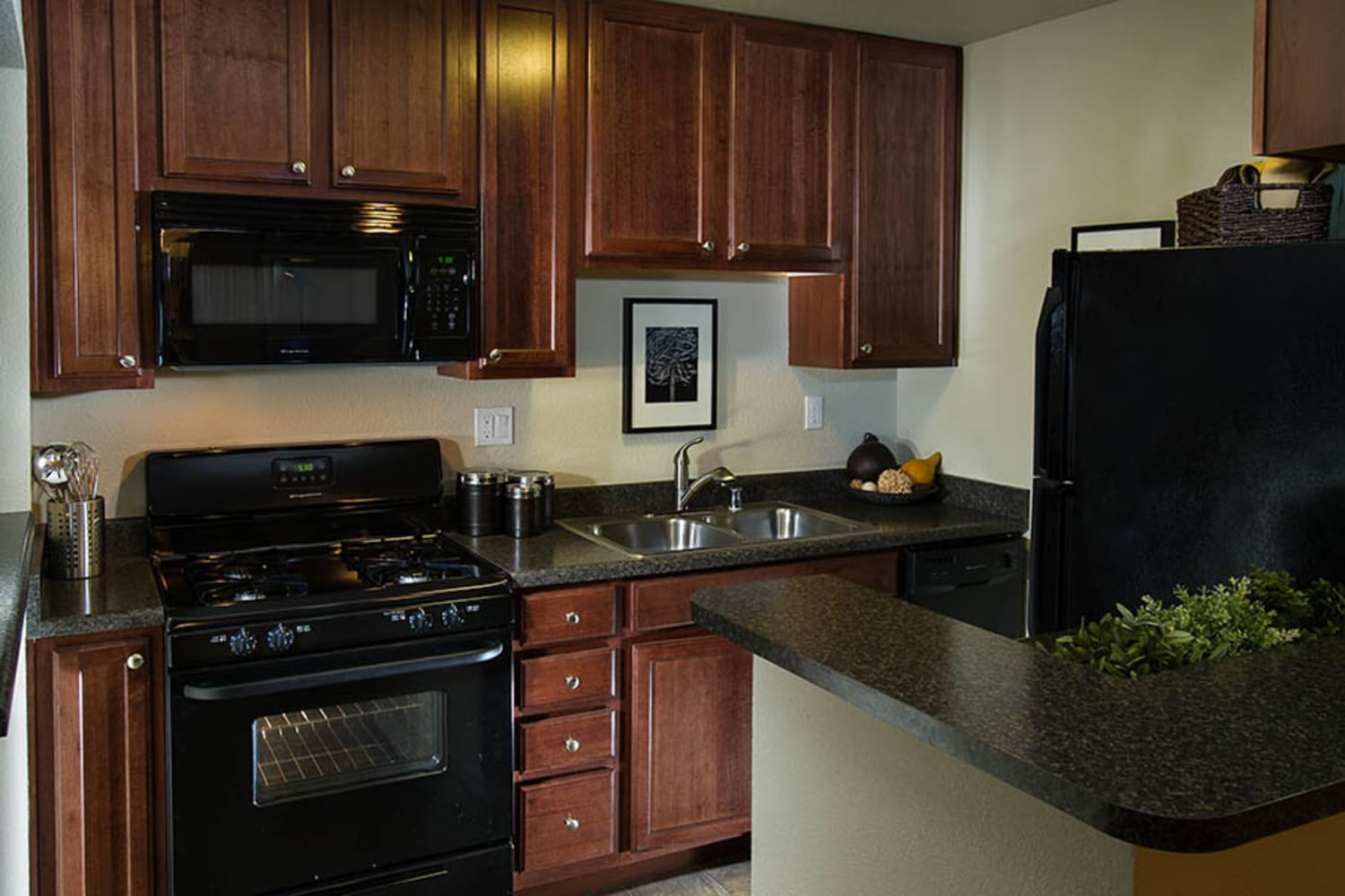 Well appointed kitchen at UCA Apartment Homes in Fullerton, California