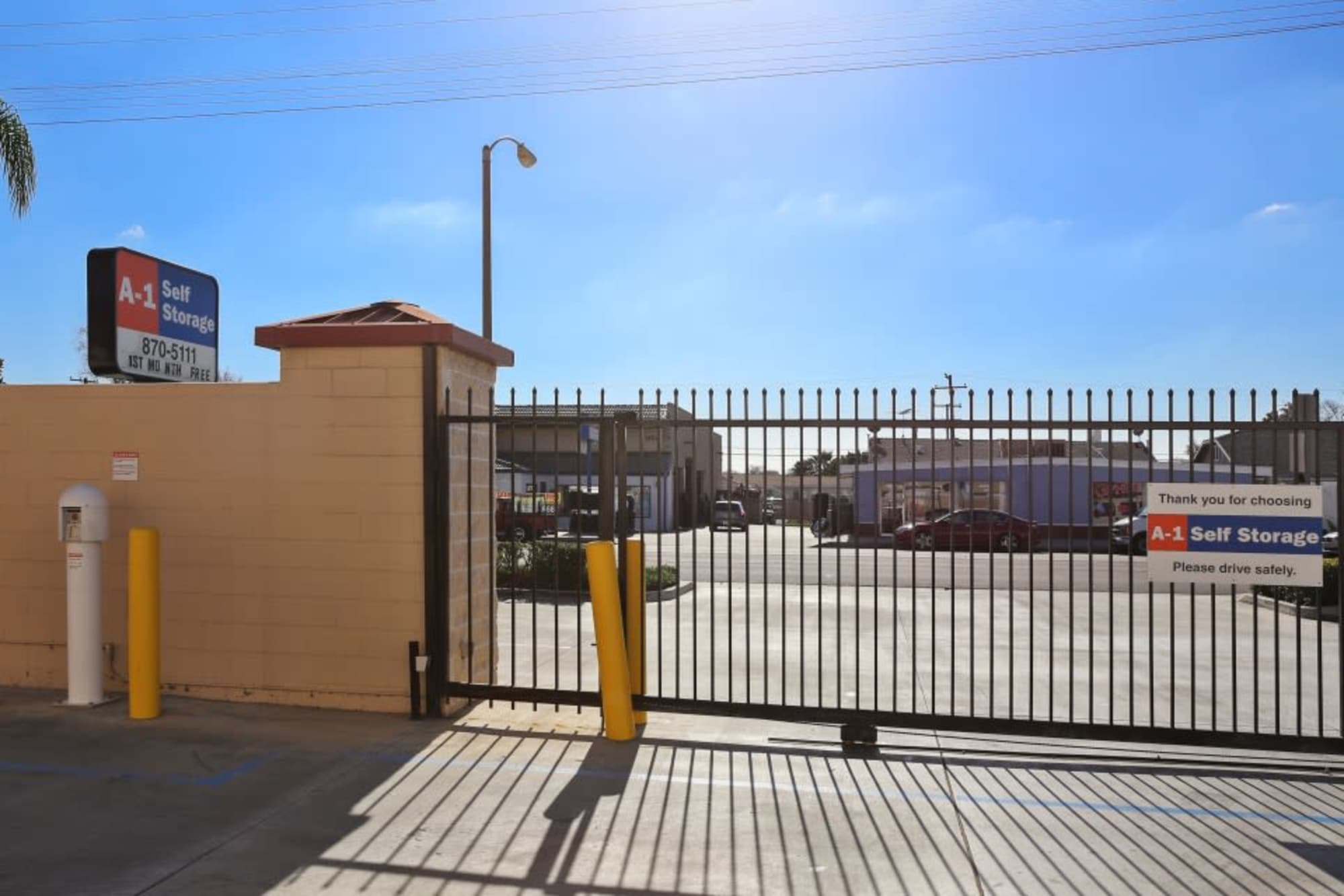 The secure code-access gated entrance at A-1 Self Storage in Fullerton, California