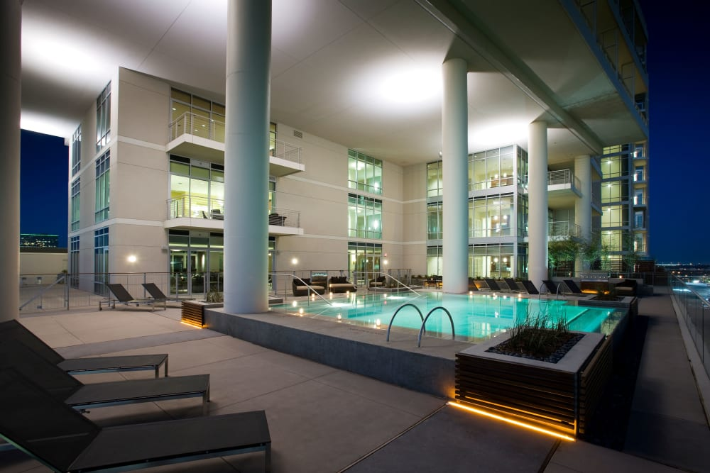 The Heights at Park Lane's gorgeous exterior with a swimming pool in Dallas, Texas