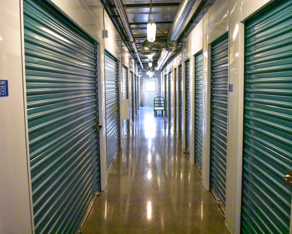 Green doors on interior climate-controlled storage units at STOR-N-LOCK Self Storage in Redlands, California