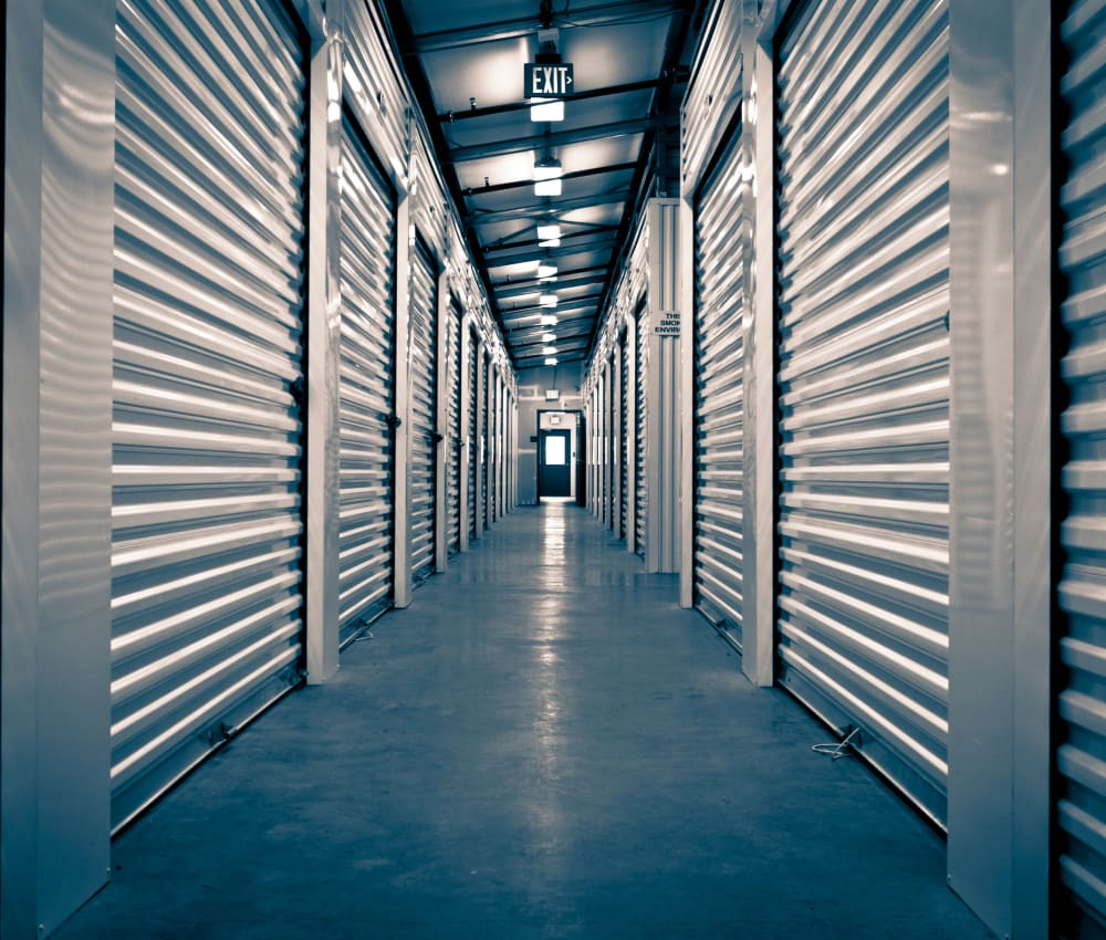 Row of indoor storage units at Store It All Self Storage - Del Norte in Laredo, Texas