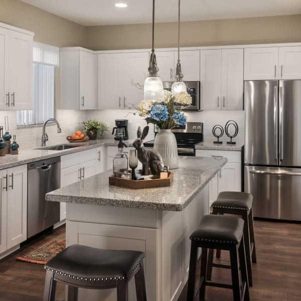 Modern kitchen with stainless-steel appliances in model home at San Villante in Mesa, Arizona