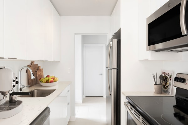 Fully equipped kitchen with stainless-steel appliances at Fraser Tolmie Apartments in Victoria, British Columbia