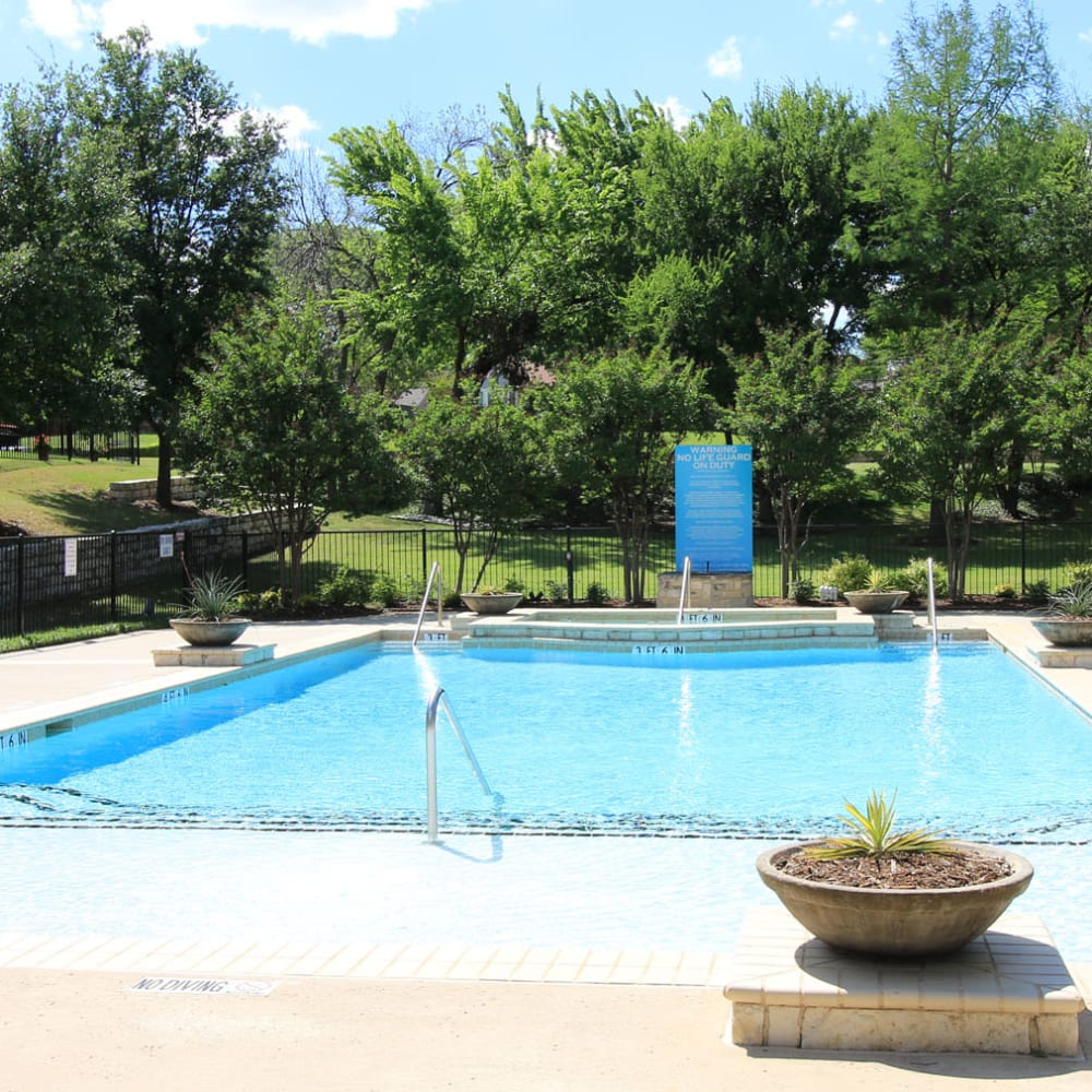 Fountains in the swimming pool at Oaks Estates of Coppell in Coppell, Texas