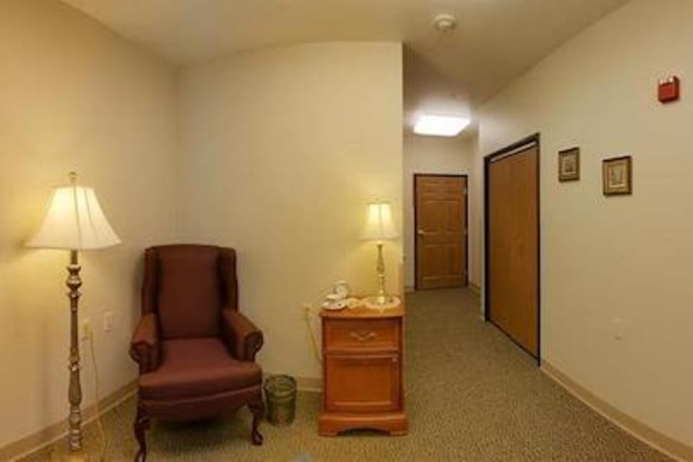Resident studio apartment living area and large closet at Milestone Senior Living in Rhinelander, Wisconsin.