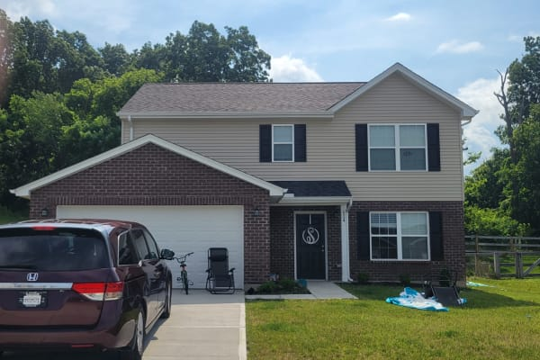 Two-story home in Ft. Wright with a minivan in the driveway.