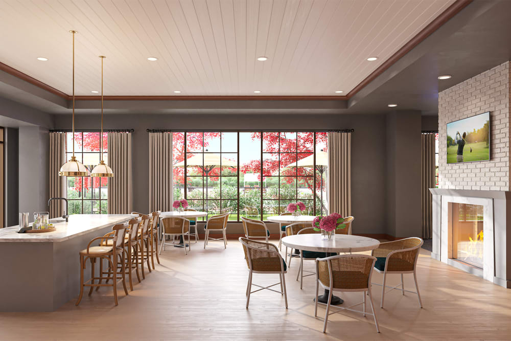 Cafe dining room with a fireplace and a serving bar at Amira Minnetonka in Minnetonka, Minnesota