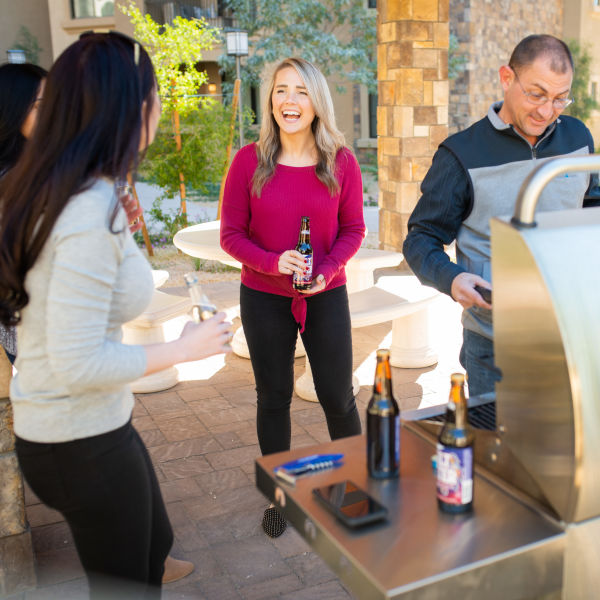 Residents firing up the gas grills and enjoying some beverages at San Hacienda in Chandler, Arizona