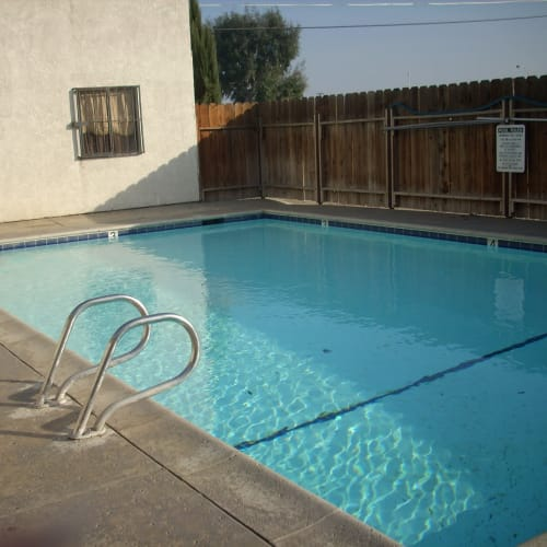 View of the swimming pool at El Potrero Apartments in Bakersfield, California