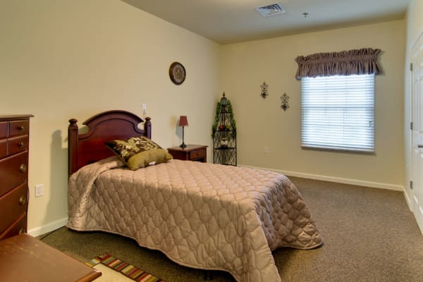 Assisted living apartment bedroom at Schilling Gardens Senior Living in Collierville, Tennessee