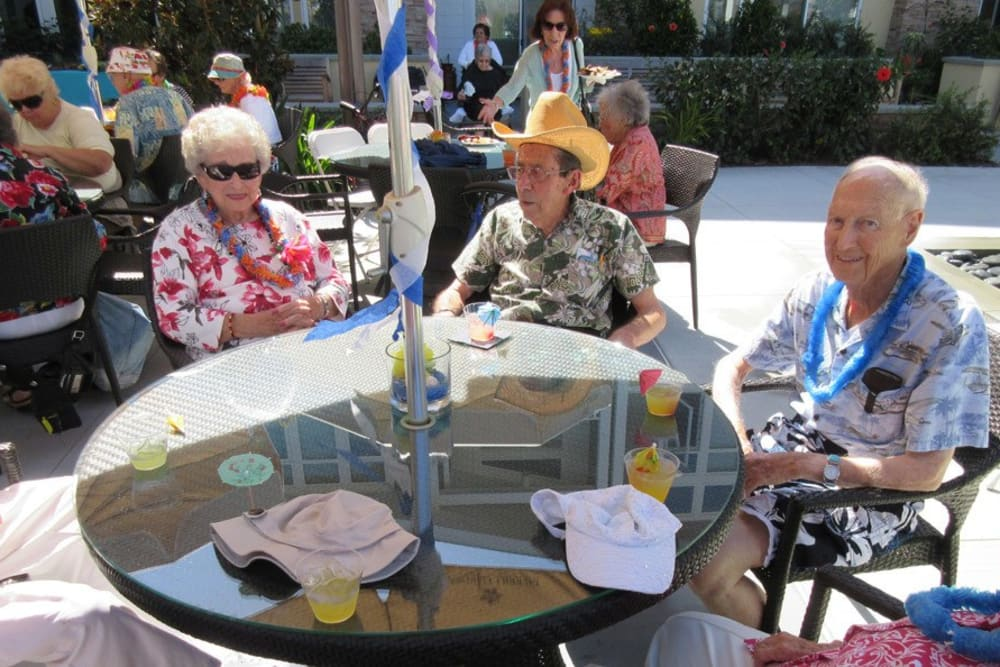 Residents Enjoying the Patio at Merrill Gardens at Huntington Beach in Huntington Beach, California.