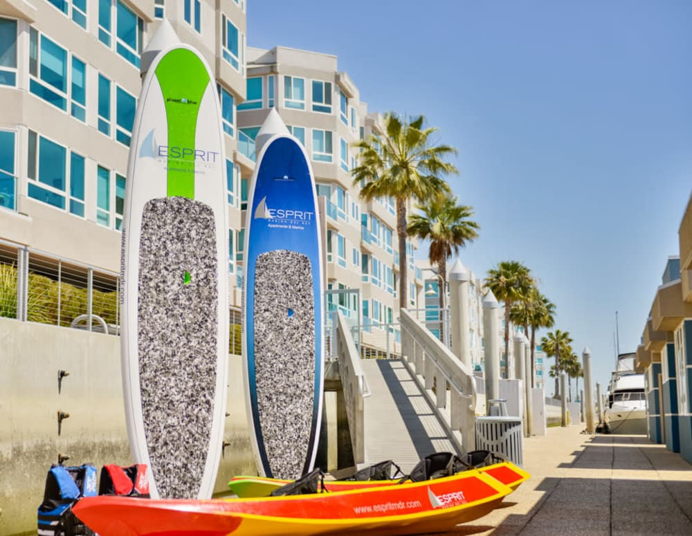 Surfboards and paddleboards outside for resident use at Esprit Marina del Rey in Marina Del Rey, California