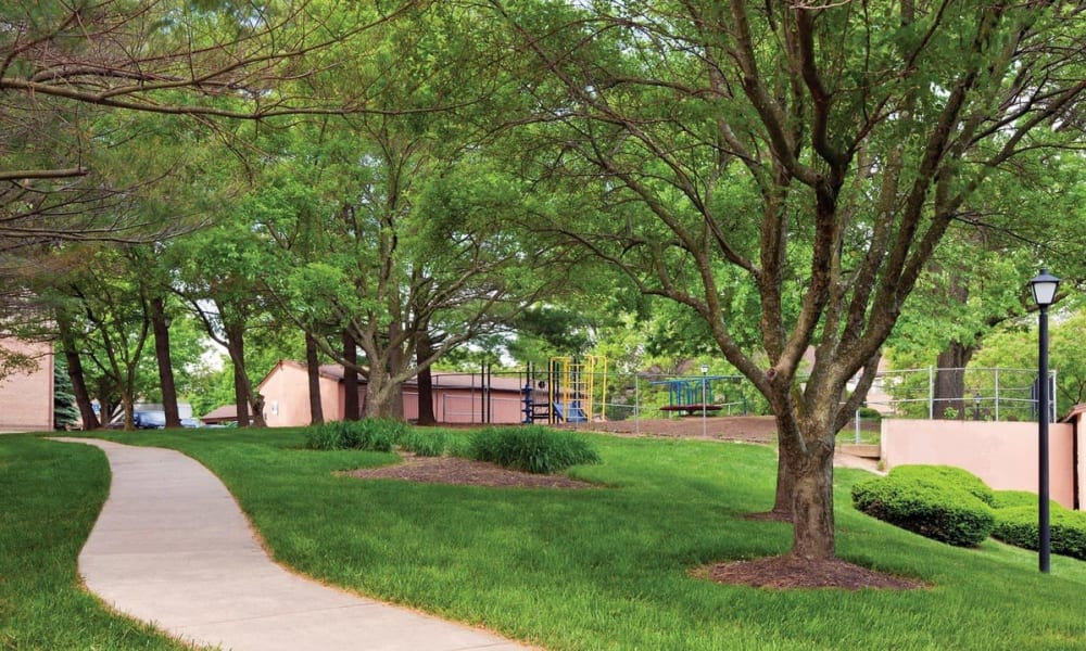 Well-maintained landscaping and mature trees at The Chimneys of Cradlerock Apartments in Columbia, Maryland