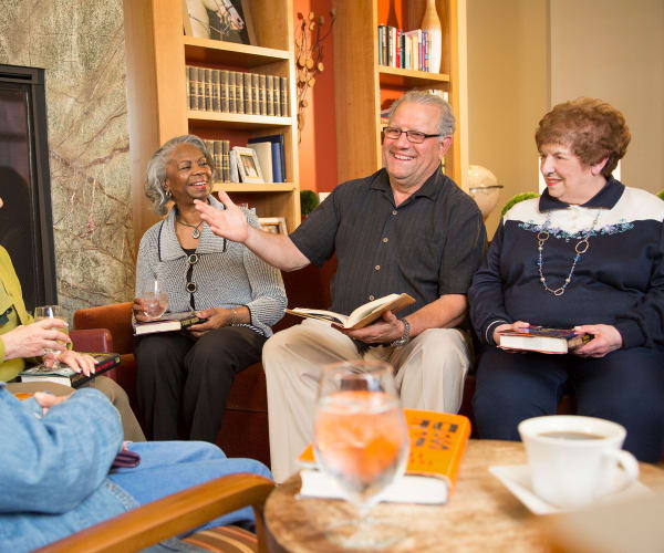 Residents gathered around for book club at All Seasons of Birmingham in Birmingham, Michigan